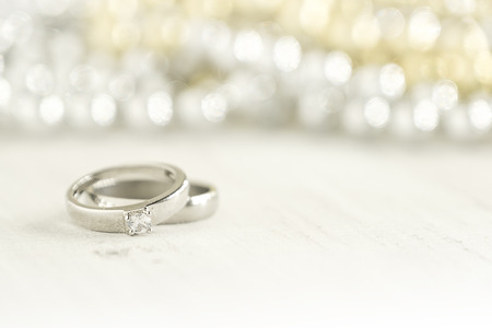 Two wedding rings place on wooden background