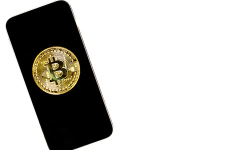 Golden Bit coin on Mobile phone  on white  background