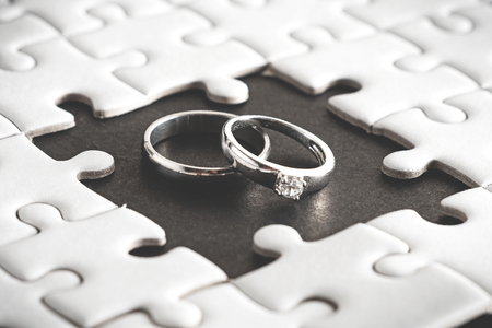 Wedding rings appear on blank space of jigsaw puzzle,two heart ,soul mate born to living together