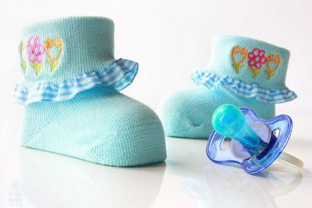 Children socks and nipple photo