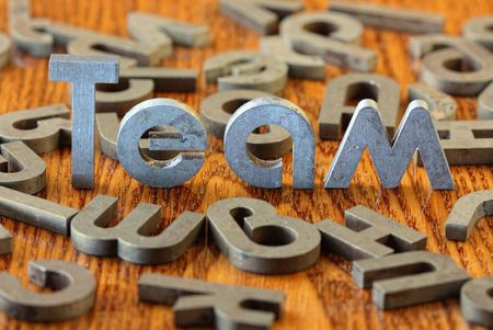 creative industries: Word team of iron letters Stock Photo