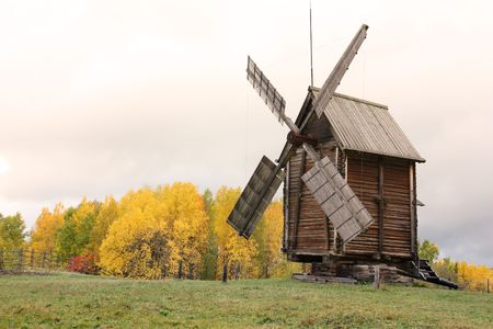 Old wooden windmill in the trees windmills in the clearing  photo