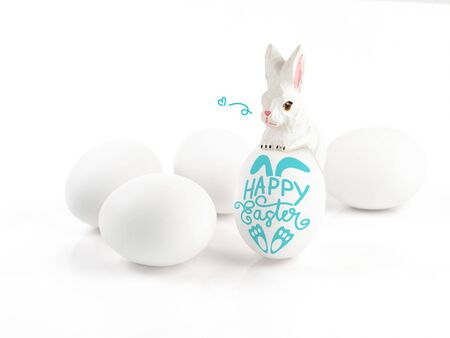 Happy Easter lettering on egg and wood rabbit on white background, Easter design with cute bunny and text, hand drawn illustration