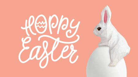 Happy Easter lettering with egg and wood rabbit on orrange background, Easter design with cute bunny and text, hand drawn illustration Reklamní fotografie
