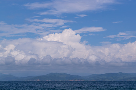 The sea scene. Clouds thicken over the bay