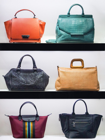 Handbags in the storefront of a fashion boutique store on the shelves