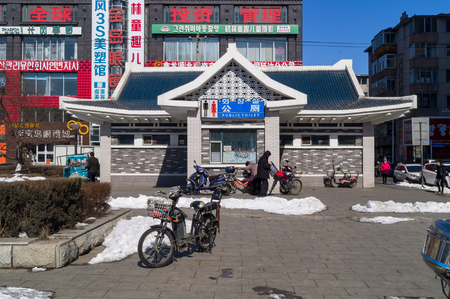 YANJIXI, JILIN, CHINA - March 8, 2018: Public toilet on the street in the Chinese city Yanjixi of northern province. Modern building in traditional Asian oriental style Editorial