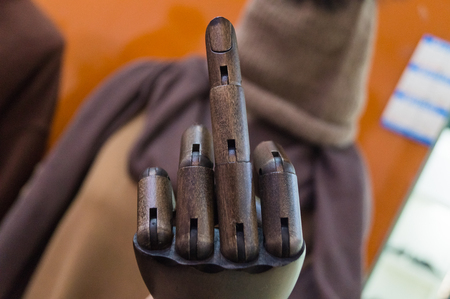 Gesture of fucking you. Mannequins hand shows aggressive gesture with the middle finger as fuck you close up Фото со стока