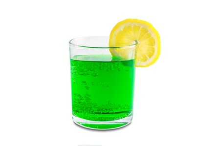 Coconut Green Soda With Lemon On The Edge Of A Transparent Glass And Minty Aroma
