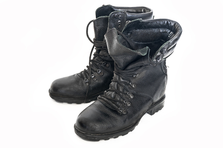 Old, worn-out boots of the Russian army of the old type, used by hunters, fishermen and tourists for outdoor activities Stock Photo