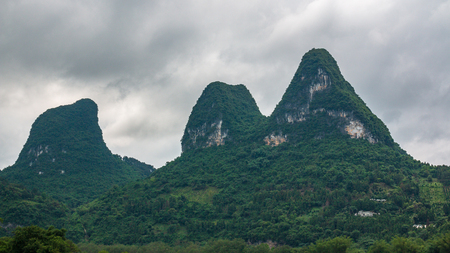 Karst peaks in Xingping Town and the cattle next to Li River known as Lijiang River. Фото со стока