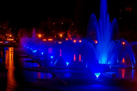 Glowing multicolored illumination fountains in the Far Eastern city of Khabarovsk. Autumn show of singing fountains at the closing of the summer season.