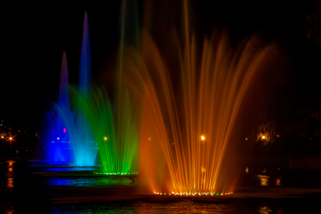 Glowing multicolored illumination fountains in the Far Eastern city of Khabarovsk. Autumn show of singing fountains at the closing of the summer season.