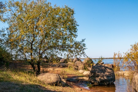 The bank of the Amur River not far from the far-eastern city of Khabarovsk near the village of Sikachi Alyan where the ancient petroglyphs carved on stones are located