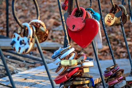 Padlock as a sign of eternal love newlyweds mounted on the bridge. Romantic tradition in marriage.