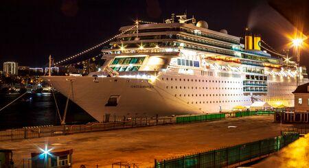 VLADIVOSTOK, RUSSIA - SEPTEMBER 12, 2018: Ocean liner Costa Romantica moored at night on the pier in the downtown of the Far Eastern city of Vladivostok Editöryel