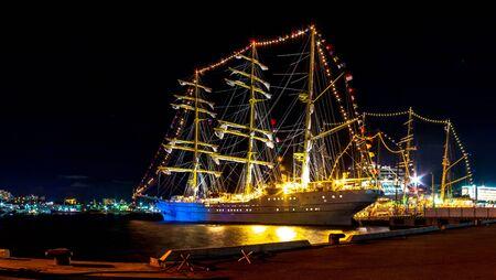 VLADIVOSTOK, RUSSIA - SEPTEMBER 12, 2018: : Indonesian sailboat KRI Bima Suki moored at night on a jetty in the downtown of the Far Eastern city of Vladivostok during an international sailing regatta