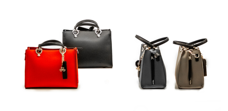 A set of stylish and modern women's handbags from fresh and relevant models of red and beige colors with black and gray elements. Isolated on white background