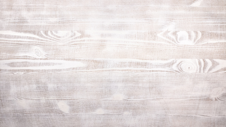 White slightly stained rustic wooden background of table with a distinct texture of wood fibers and knots with horizontal pattern for mockup or design template in building, food or industrial pattern sample layout. Imagens