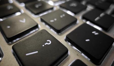 backlit keyboard: computer keyboard question mark Stock Photo