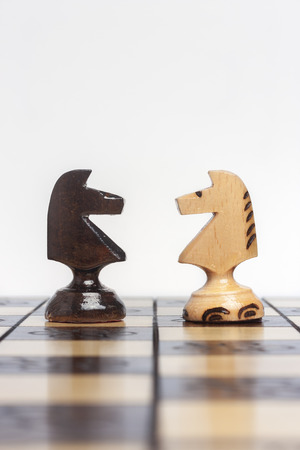 facing each other: Chess pieces facing each other to symbolize a challenge