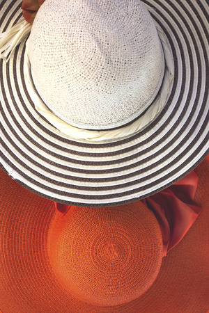 viejo: Lady straw hat with decorative flower ribbon Stock Photo
