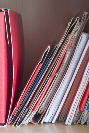 categorize: Stacks of colored folders with documents on the desktop