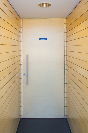The front door of a bathroom of a shopping center with perspective lines come game. Modern industrialization concept Stock Photo