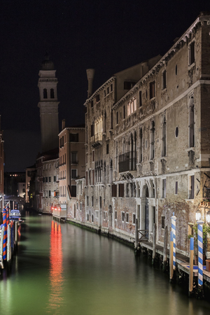 A night glimpse of the Rio dei Greci Canal and in the background the typical Venetian Bell Tower to convey a concept of tourism