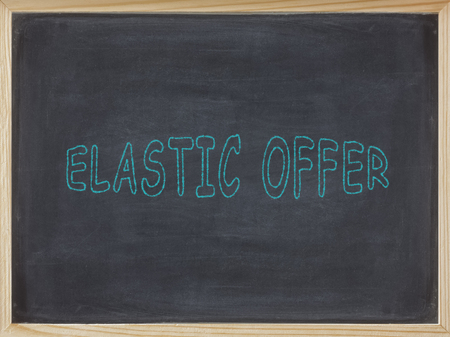Elastic Offer meat written on a blackboard to mean a business concept Stock Photo