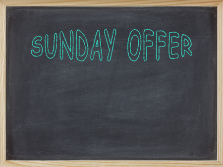 Sunday Offer meat written on a blackboard to mean a business concept