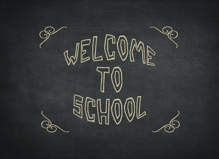 The phrase Welcome to School written in white chalk on a blackboard a vignette has been added for effect to mean a concept