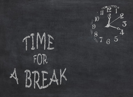 Time for a break clock with text on black background to mean a concept Banco de Imagens