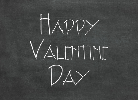 Text Happy Valentine Day written on blackboard to mean a concept Stok Fotoğraf