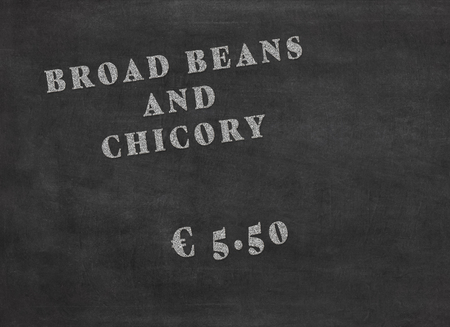 Offer of a meal broad beans and chicory for an amount of 5.50 euros. White words on a black chalkboard to mean a concept