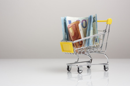 Shopping trolley full of euros, isolated on white background to mean a concept Stock fotó