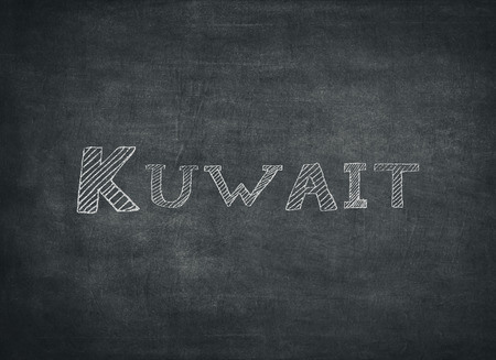 The word kuwait written on a blackboard