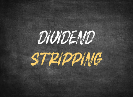 Dividend Stripping on chalkboard background