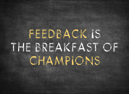 Feedback is the breakfast of champions on chalkboard background