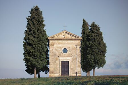 Popular photography and touristic location in Tuscany, amazing Vitaleta chapel at colorful sunset, Pienza, Tuscany, Italy, Europe. Travel background