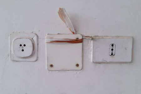 Telephone wall socket and vintage electricity in Italy to mean a concept