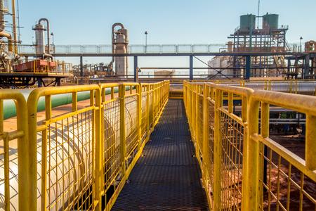 metallic stairs: handrail industrial yellow fence metallic Stock Photo