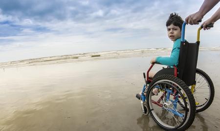 Childlike wheelchair horizon sand