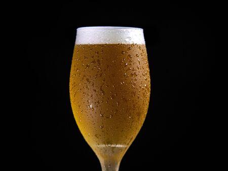 Droplets on freshly poured beer detail macro delicious unfocused
