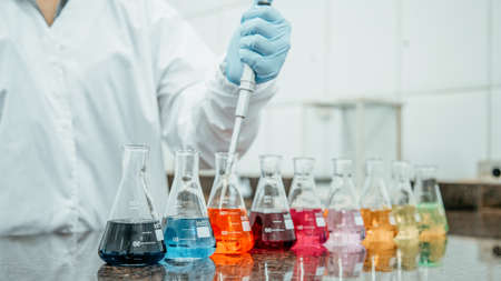 Laboratory test beaker with colored liquids Фото со стока