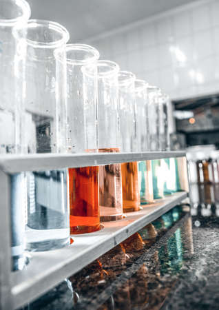 Laboratory test beaker with colored liquids Фото со стока