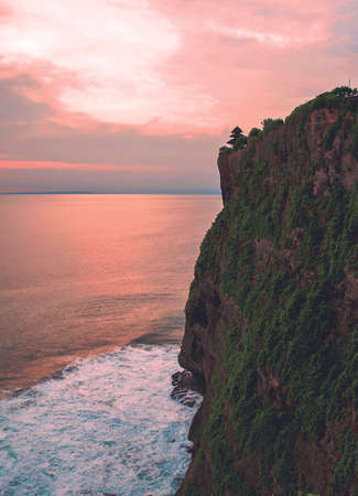 Beautiful Sunshine From the Cliffs of The Uluwatu Temple. This temple is located on a rock with a height of about 97 meters above sea level.