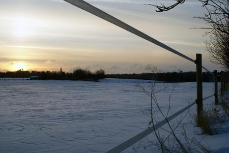 Sunrise over winterfield Stock Photo