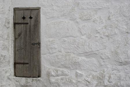 Secret door of wood in ancient wall Stock Photo