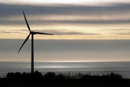 countrysides: Dark clouds over wind turbine Stock Photo